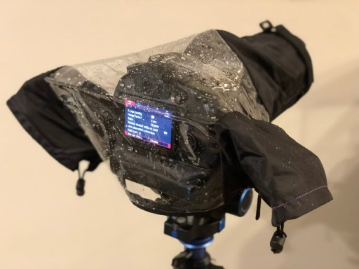 The dslr rain cover keeps your camera dry, while letting you see and use the camera.