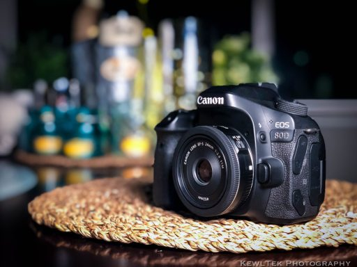 Canon 80D DSLR camera with the 24mm f/2.8 STM prime lens attached.