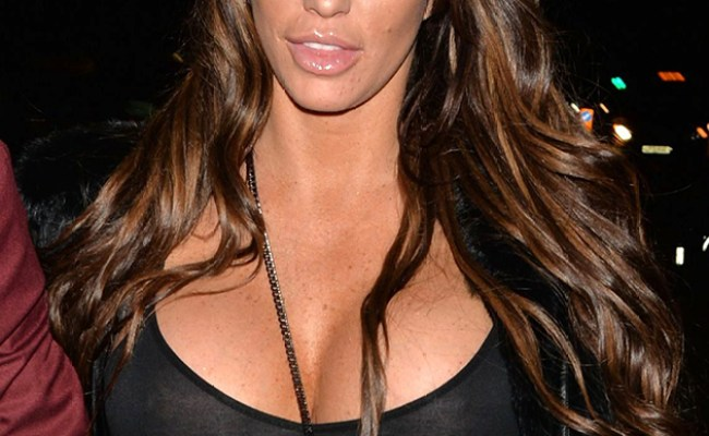Katie Price Poses In A Swimsuit During Family Day Out With