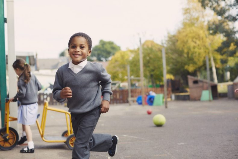 boy running in the playground - back to school safety