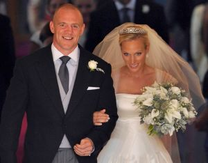 Mike Tindall (L) and his new bride Britain's Zara Phillips in 2011