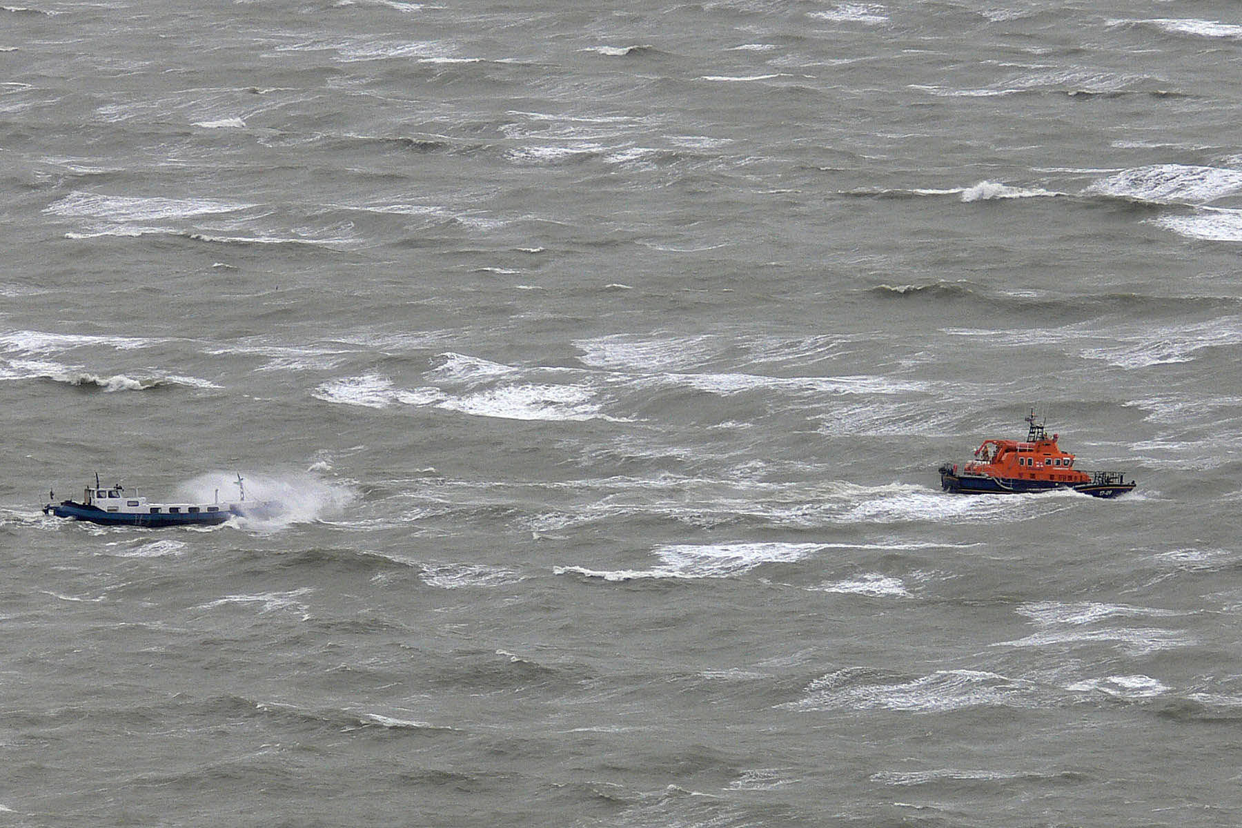 Lifeboat rescues canal boat at sea in F8 winds and huge