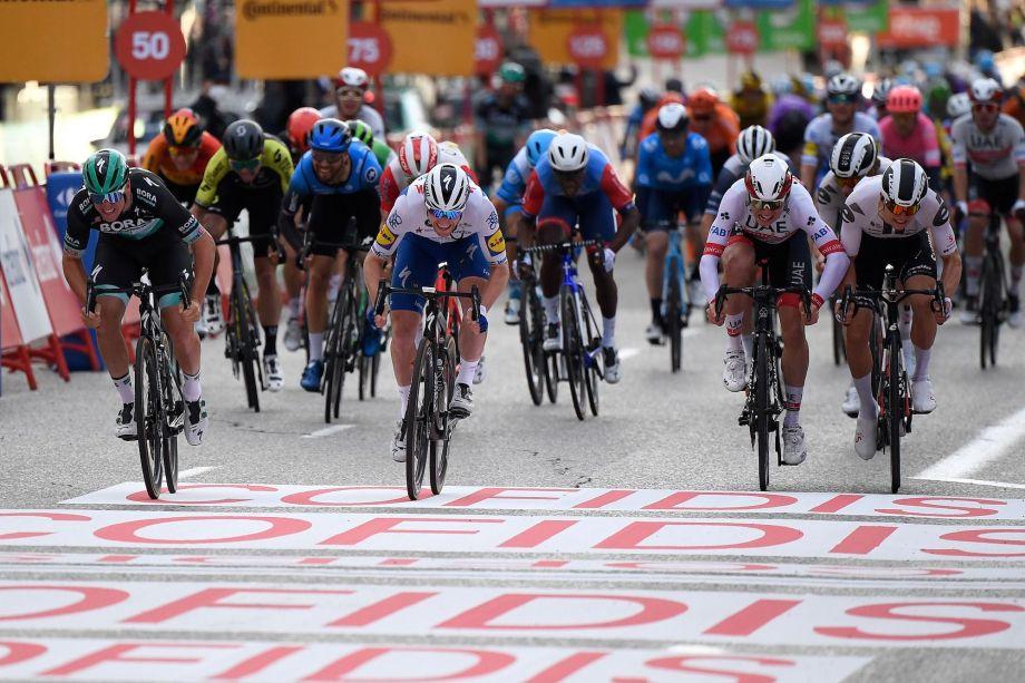 Pascal Ackermann pips Sam Bennett in stage 18 sprint as Roglič seals Vuelta a España