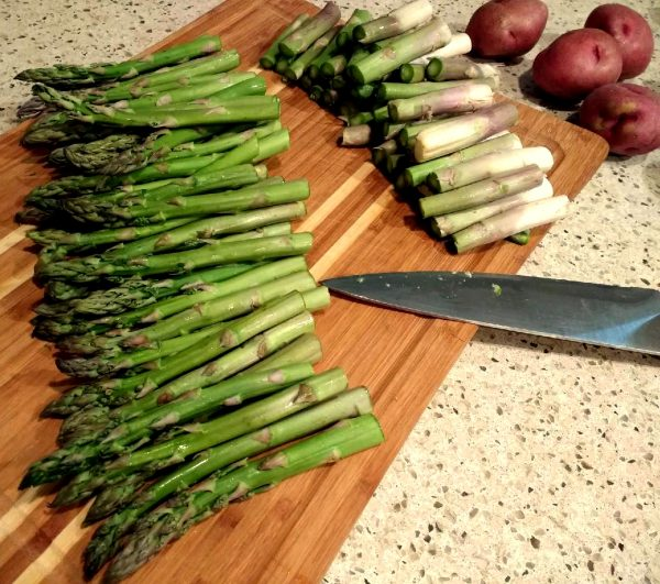 Cut asparagus for roasted red potatoes