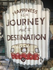 Happiness is the Journey and not the destination sign