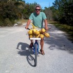 Brian Branigan with a basketful of coconuts