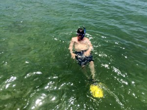 in water with snorkel gear