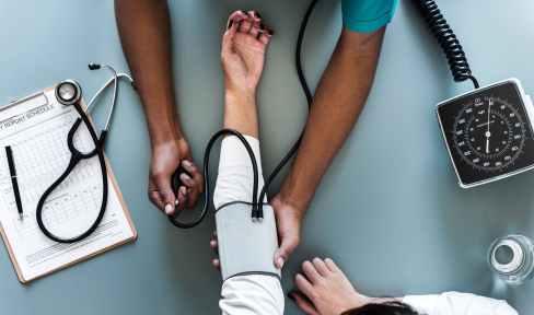 person using black blood pressure monitor