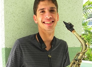 A person posing for the camera - Saxophone