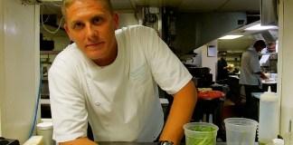 A man preparing food in a kitchen - Drink