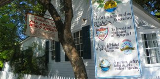 #Summertime: Time for the locals to rejoice! - A sign above a store - Key West