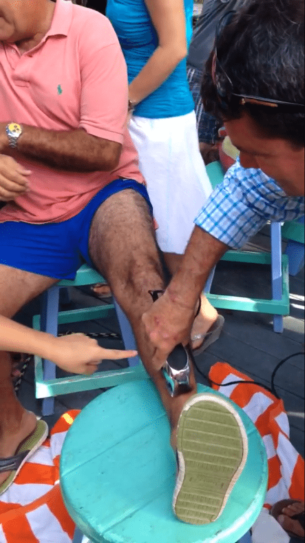 #News: County Administrator loses bet and leg hair - A group of people sitting at a table - Thigh