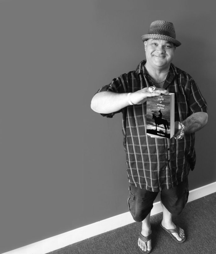 Local radio guy publishes western book – Mark Ryno releases 'The Sheriff of Whiskey Hollow' - A person standing posing for the camera - Human behavior