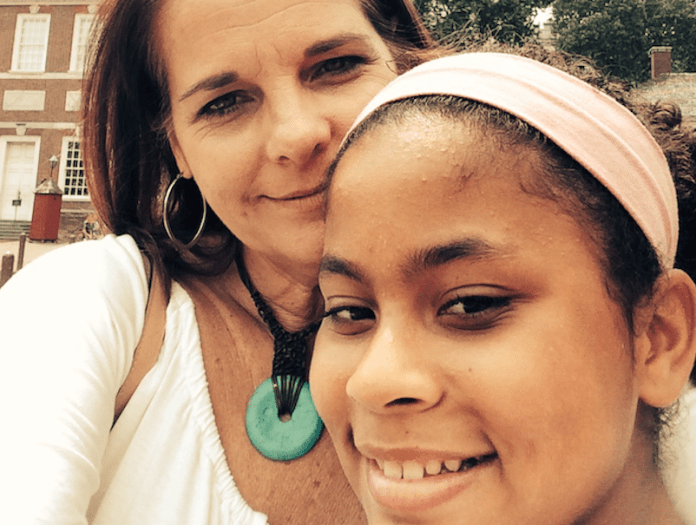 #Fact: 16 children in the Keys have no place to call home - A woman smiling for the camera - Eye
