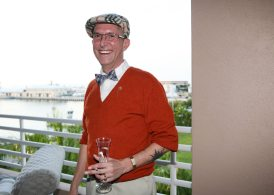 Golf anyone? Randall Becker sports casual links attire.