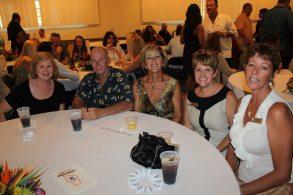 Jo Ann Cook et al. sitting at a table - Banquet
