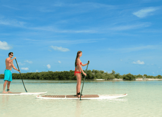 #DayTripping: Fury Water Adventure & Sunset Celebration - A man standing next to a body of water - Fury Water Adventures Key West