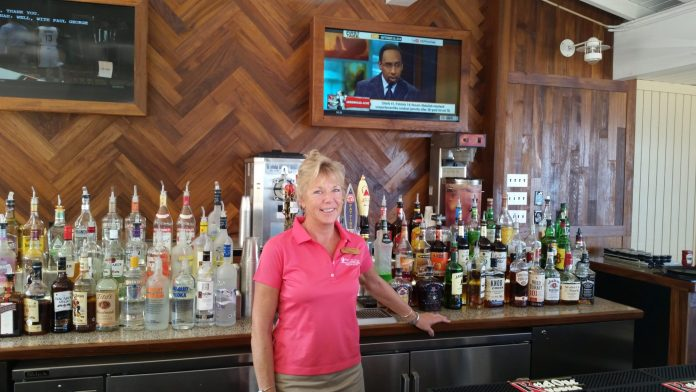 #Libation: Beach Bar and Grille, Pier House Resort - Stephen A. Smith standing next to a bottle of wine - Liquor
