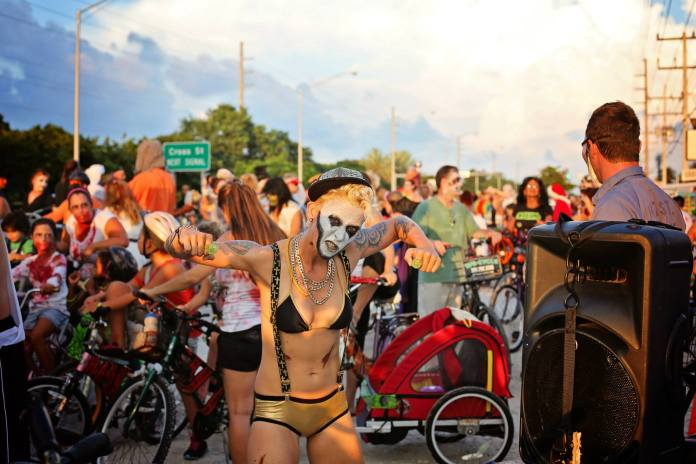 #Events: Zombie Bike Ride happens Sunday - A group of people riding on the back of a bicycle - Bicycle