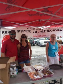 Alex Osborn, Aileen Garrido and Kathy Yearsley serve food at the fundraiser.