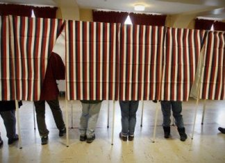 #Elections: Referendum explanations - A group of people standing in a room - Voting