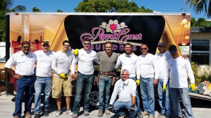 The Royal Crest crew poses with TV show host Matt Blashaw, center, in front of a renovation project located in Marathon's Little Venice neighborhood.