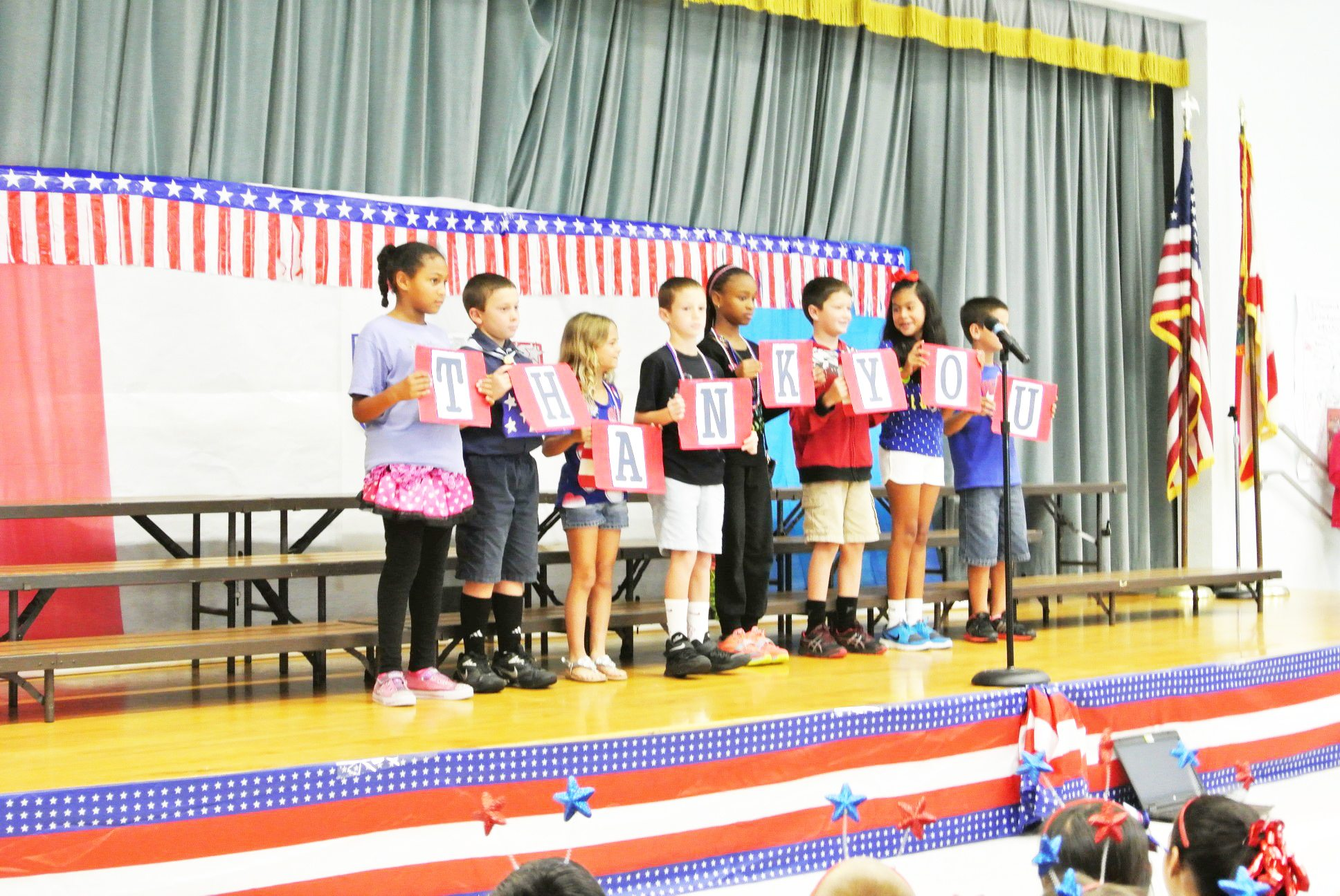 Students and staff at Switlik School celebrate the annual Red White, and Blue Day on Friday to honor veterans and service personnel with poems, songs and essays. Pictured is Mrs. Meier's first grade class.