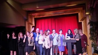 The 2015 Key West Association of Realtors Board of Directors are sworn in before a sold out crowd.