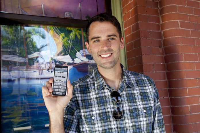 #News: Key West Art & Historical Society Wins Prestigious $20,000 Award - A man standing in front of a building talking on a cell phone - Tartan