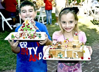 #Events: Free gingerbread house-making party for kids of all ages - A little girl sitting at a table with a birthday cake - DISH