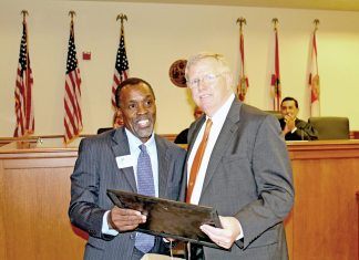 #Seen Around Town: Circuit Judge Timothy J. Koenig is sworn in - A man in a suit and tie - Judge