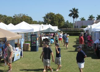 Pigeon Key Art Festival is this weekend - A group of people in a tent - Pigeon Key