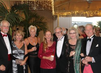 Dinner-dance recognizes Holly Merrill - A group of people posing for a photo - Holly Merrill Raschein