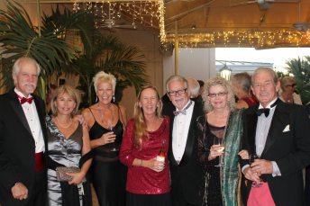 Jon McIntosh, Rita Linder, Perry Arnold, honoree Holly Merrill, Rosi Ware, Janet Bengel and husband Charlie celebrate Merrill's accomplishment.