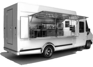 Planning considers food truck law - A white and black truck sitting on the side of a building - Food truck