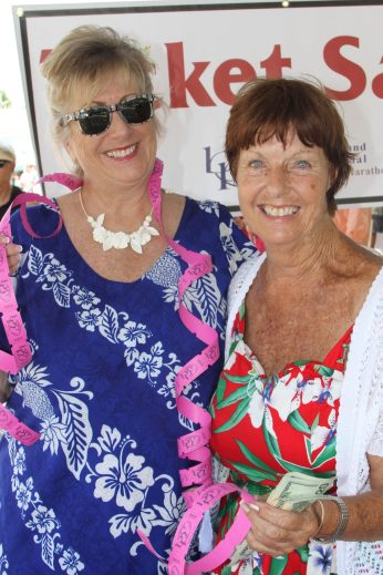 Patty Ivey and Barbara Paget sell taste tickets for BPW.