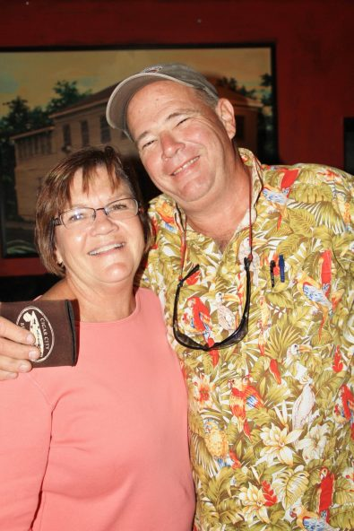 Runner Tricia Eables registers for the race with Joe Crehan. On the following day, she finished third in her age division in the race.