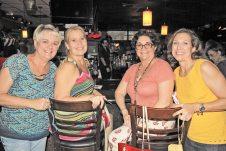 Bottle Cap Owner Carolyn Sullivan and Rotary's Janie Baucom, Rachel Oropeza and Terri Labrada wait to find out if they won the 50/50 raffle.