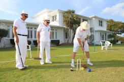 Second place winners Stu Kaufman taps his way to a lead. Chuck Gillmore and croquet partner Ed Cole oversee the process.
