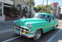 All things Cuba – The Weekly visits the Island 'A Million Miles Away' - A green truck parked in front of a blue car on a street - Car