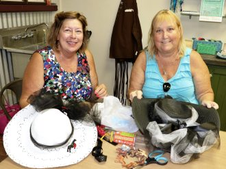 Cathy Henninger and Mary Conley create wearable works of art for the upcoming two-minute race next Saturday.
