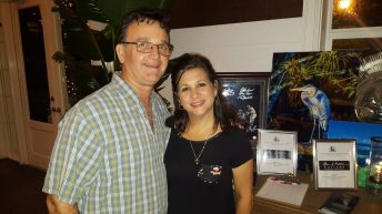 Key West Fire Dept Captain Mike Davila and his wife peruse the myriad of auction items inside Latitudes.