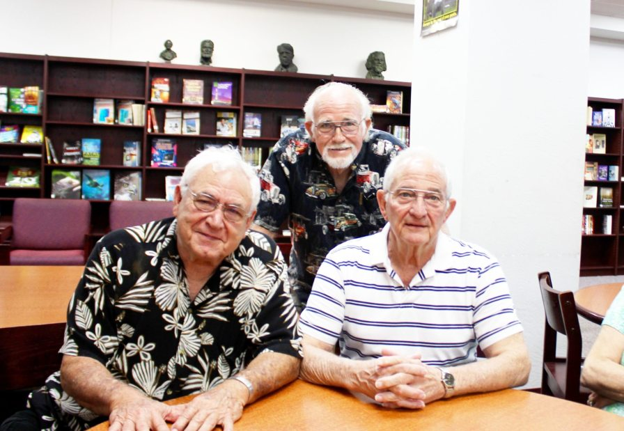 Alumni and former Fighting Conchs, Darold Leto, left, Mike Horne and Nelson Sawyer honor their famous schoolmate from the 1960s.