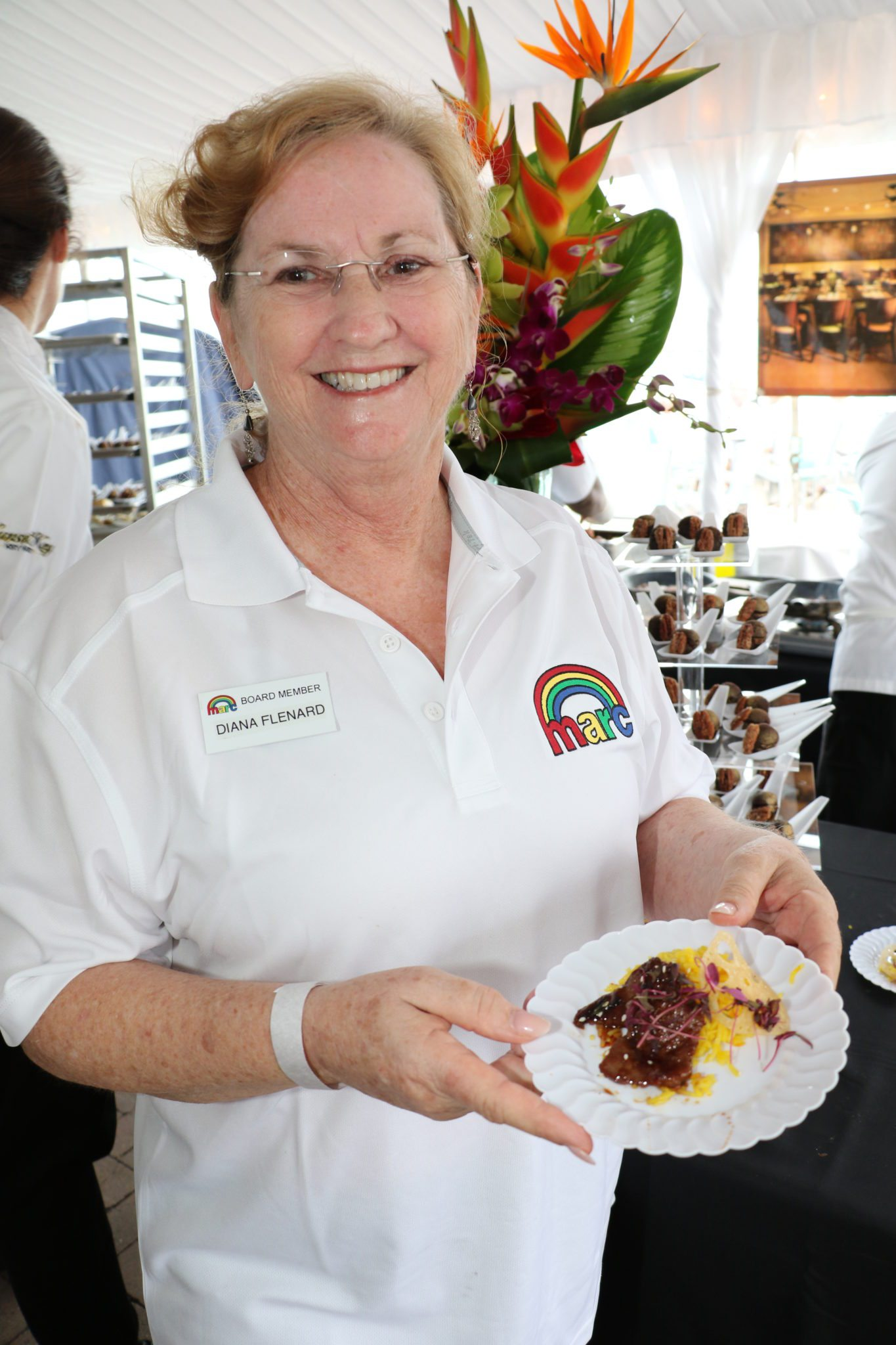 Diana Flenard, MARC House's Executive Director, shows off a tasty creation from Firefly at Sunday's event.