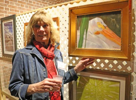 Gingerbread Square Gallery Artist Jane Washburn shows her white pelican oil on canvas painting, 'Snow Bird.'