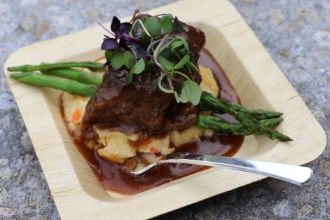 Bagatelle prepared a braised short rib over a sofrito polenta and a burgundy demi with grilled asparagus.