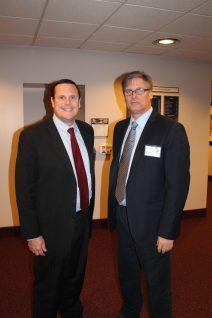 Robert Lockwood and Scott Russell talk politics on the House Floor in Tallahassee.