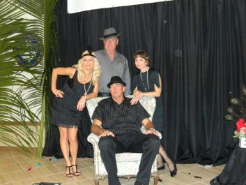 Gary, Joy and Melissa Wilson pose in the photo booth. Or is it rest? Dale Bittner might be resting.