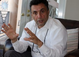 A conversation with Dr. Aydin Atilla, ER Director at LKMC - A man sitting in a chair - Lower Keys Medical Center