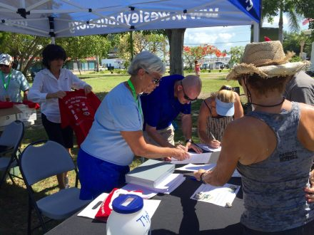 Volunteer Eileen Dugan had already registered 50 bicycles to ride together through old town.